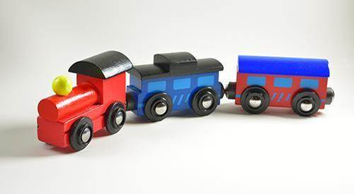 Case study - Wooden toy train with colorful blocs isolated