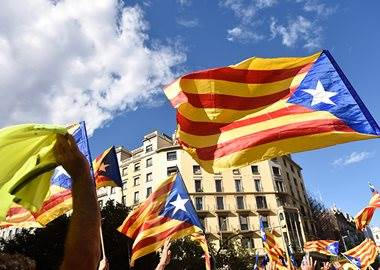 Euro hit by Spain imposing direct rule on Catalonia