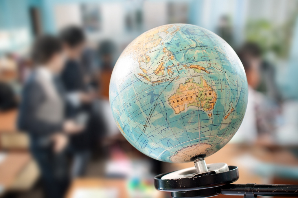globe against the background of a school class