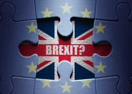Missing piece from a European jigsaw puzzle revealing British flag and Brexit question symbolising emigrating after Brexit
