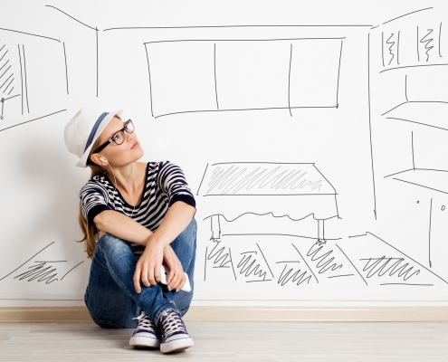 Dreaming woman in headset over drawn living room background Concept to real estate investment