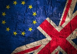 Image relative to politic relationships between Europe Union and United Kingdom. National flags on concrete textured backdrop. Brexit and UK art theme.