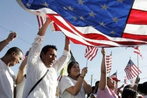 People holding USA flag in a crowd during a shining day. Concept of emigrating to USA at 50 years old