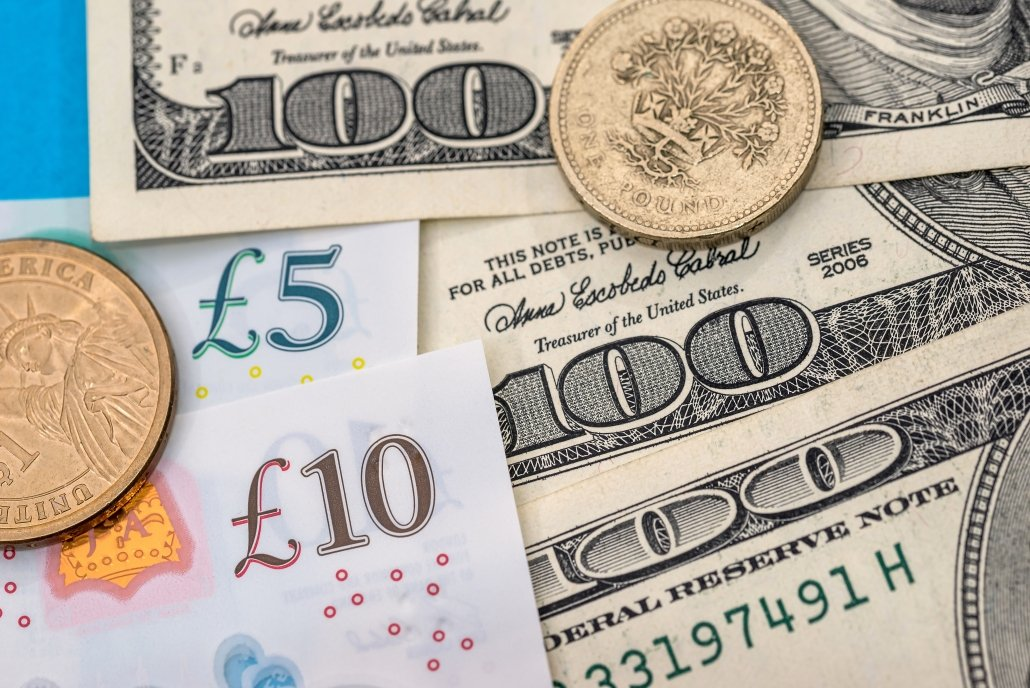 US Dollar and Pound - banknotes and coin. Concept economic data from US Eurozone and UK