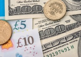 US Dollar and Sterling- banknotes and coin. GBP-USD concept